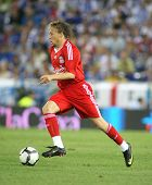 BARCELONA - AUGUST 2: Lucas Leiva, Brazilian player of Liverpool FC, in action during a friendly match against RCD Espanyol at the Estadi Cornella-El Prat on August 2, 2009 in Barcelona, Spain.