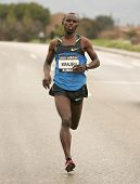 BARCELONA - FEBRUARY 1: The Olympic Marathon champion in Beijing 2008, Samuel Wanjiru, running durin
