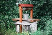 Old Water Well In The Garden. Vintage Draw Well In European Village poster