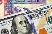 A Macro Image Of A Belize Two Dollar Bill In Macro With A Blue American One Hundred Dollar Bill poster