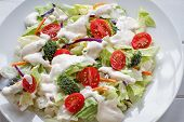 Plate Of Homemade Fresh Salad With Buttermilk Ranch Dressing, Tomatoes, Broccoli, Cabbage And Carrot poster