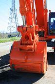 stock photo of oversize load  - Orange excavator close up on a construction sight - JPG