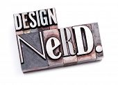 "The phrase ""Design Nerd"" in letterpress type. Cross processed, narrow focus."
