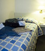 image of guayaquil  - hotel room open suitcase clothes on bed guayaquil ecuador - JPG