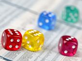 Colorful dice on financial report