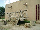 image of hacienda  - old cart in front of la hacienda de los martinez in taos - JPG