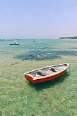 Wooden Boat In Shallow Water