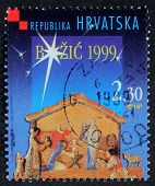 CROATIA - CIRCA 1999: A greeting Christmas stamp printed in the Croatia shows Christmas Creche, circa 1999