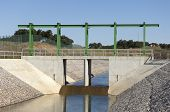 stock photo of upstream  - Almost finished sluice gate in the water diversion canal upstream the Alvito reservoir near Oriola village part of the Alqueva Irrigation Plan Alentejo Portugal - JPG