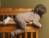 pic of bassinet  - Toddler in bedroom climbing out of her crib - JPG