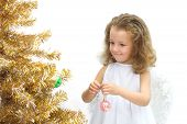 The Girl Angel Decorating A Christmas Tree