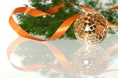 Golden Ball With Orange Ribbon And Firtree