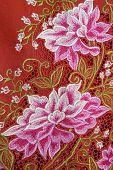 Red Kebaya Cloth With White Flowers