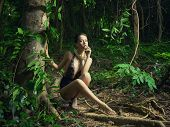 stock photo of leotard  - Glamorous lady in a lace leotard in a tropical forest - JPG