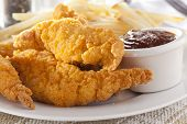 foto of grease  - Organic Crispy Chicken Strips on a background - JPG
