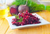 stock photo of ground nut  - Fresh salad with beet and garlic on the white plate - JPG