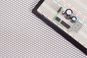 Electrical Circuit On Breadboard On Isolated Steel Background