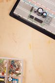 Electrical Circuit On Breadboard On Isolated Wooden Background