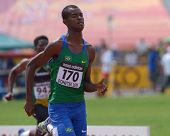 DONETSK, UKRAINE - JULY 12: Vitor Hugo dos Santos of Brazil (in front) and Sean Banda of Zimbabwe compete in 200 metres during 8th IAAF World Youth Championships in Donetsk, Ukraine on July 12, 2013