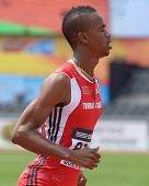 DONETSK, UKRAINE - JULY 12: Jonathan Farinha of Trinidad and Tobago win the heat in 200 metres during 8th IAAF World Youth Championships in Donetsk, Ukraine on July 12, 2013