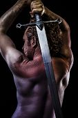 stock photo of molding clay  - Warrior with big sword - JPG
