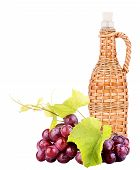 Ripe grapes and bottle of wine