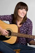 pic of acoustic guitar  - Young beautiful attractive guitar music girl smiling - JPG