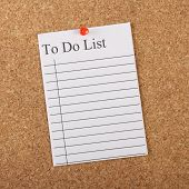 picture of efficiencies  - A To Do List pinned to a cork notice board as an aid to efficiency and productivity - JPG