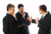 Three Young Businessmen Talk
