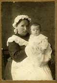 MOSCOW, RUSSIA, CIRCA 1915: Antique photo, portrait of a young woman with her daughter, circa 1915