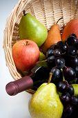 Tantalizing Fruit in Basket with Wine Bottle
