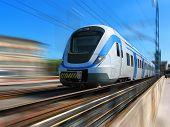 stock photo of passenger train  - White high speed commuter train with motion blur - JPG