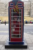 WINDSOR, UK - JULY 21: The Queen, Elizabeth II, depicted on Timmy Mallet's Ring a Royal Post Box. Art installation celebrating all things British, on July 21, 2013 in Windsor, UK.