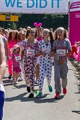 SOUTHAMPTON, UK - JULY 14: Women and unidentified children gather for the annual Race for Life to raise money for Cancer Research on July 14, 2013 in Southhampton, UK.
