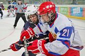 INNSBRUCK, AUSTRIA - JANUARY 18 Joshua Jacobs (USA) and Andrey Svetlakov (Russia) fight for the puck