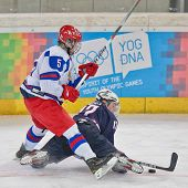 INNSBRUCK, AUSTRIA - JANUARY 18 Egor Orlov (Russia) and Jack Eichel (USA) fight for the puck as Russ
