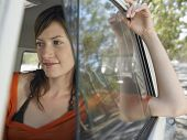 stock photo of campervan  - Closeup of beautiful young woman in campervan during road trip - JPG
