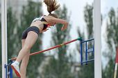 DONETSK, UKRAINE - JULY 11: Ria Mollers of Germany competes in pole vault during 8th IAAF World Yout