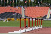 DONETSK, UKRAINE - JULY 11: Row of hurdles on the track of stadium during 8th World Youth Championsh