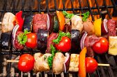 Fresh skewer on grill