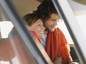 stock photo of campervan  - Loving young couple embracing in campervan - JPG