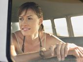 image of campervan  - Closeup of beautiful young woman in campervan during road trip - JPG