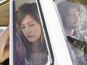 stock photo of campervan  - Sad young couple after a conflict in campervan - JPG