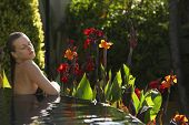 Sensuous young woman in outdoor swimming pool