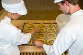 Bakers In Bakery Producing Pretzels