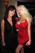 LOS ANGELES - JUL 12:  Krista Keller, Courtney Stodden at the Dave Stewart: Jumpin' Jack Flash & The Suicide Blonde Photo Exhibit at the Morrison Hotel Gallery on July 12, 2013 in West Hollywood, CA