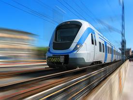 stock photo of passenger train  - White high speed commuter train with motion blur - JPG