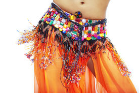 picture of belly-dance  - Body part of belly dancer in traditional costume on a white background - JPG