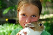 stock photo of easter bunnies  - Young girl holding a bunny - JPG