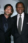 Adrien Brody and Sidney Poitier at the Giorgio Armani Prive Show to celebrate the Oscars. Green Acres, Los Angeles, CA. 02-24-07